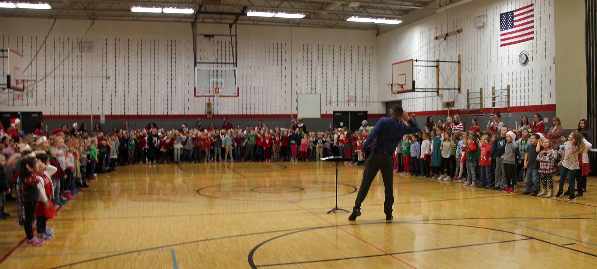 wide shot of students singing at holiday sing along