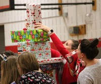 teachers stacking presents for activity