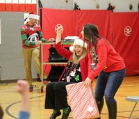 teachers taking part in activity at holiday sing along