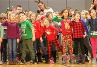 students dancing at holiday sing along