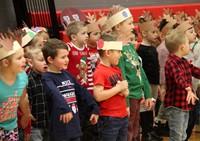 students standing wearing reindeer hats
