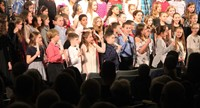students playing instruments while singing in winter concert