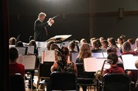 band instructor leading students in concert