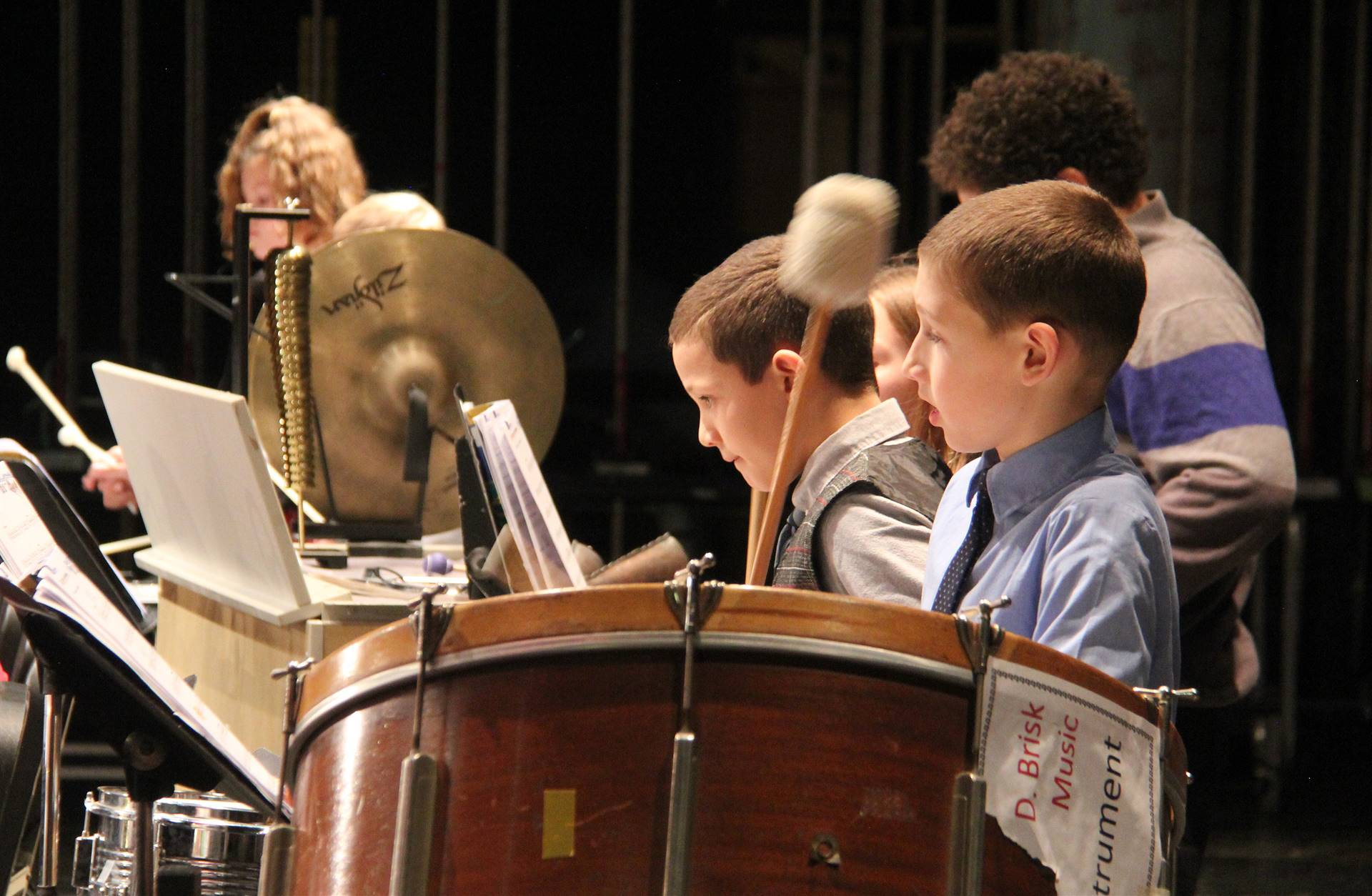 students playing percussion instruments in concert