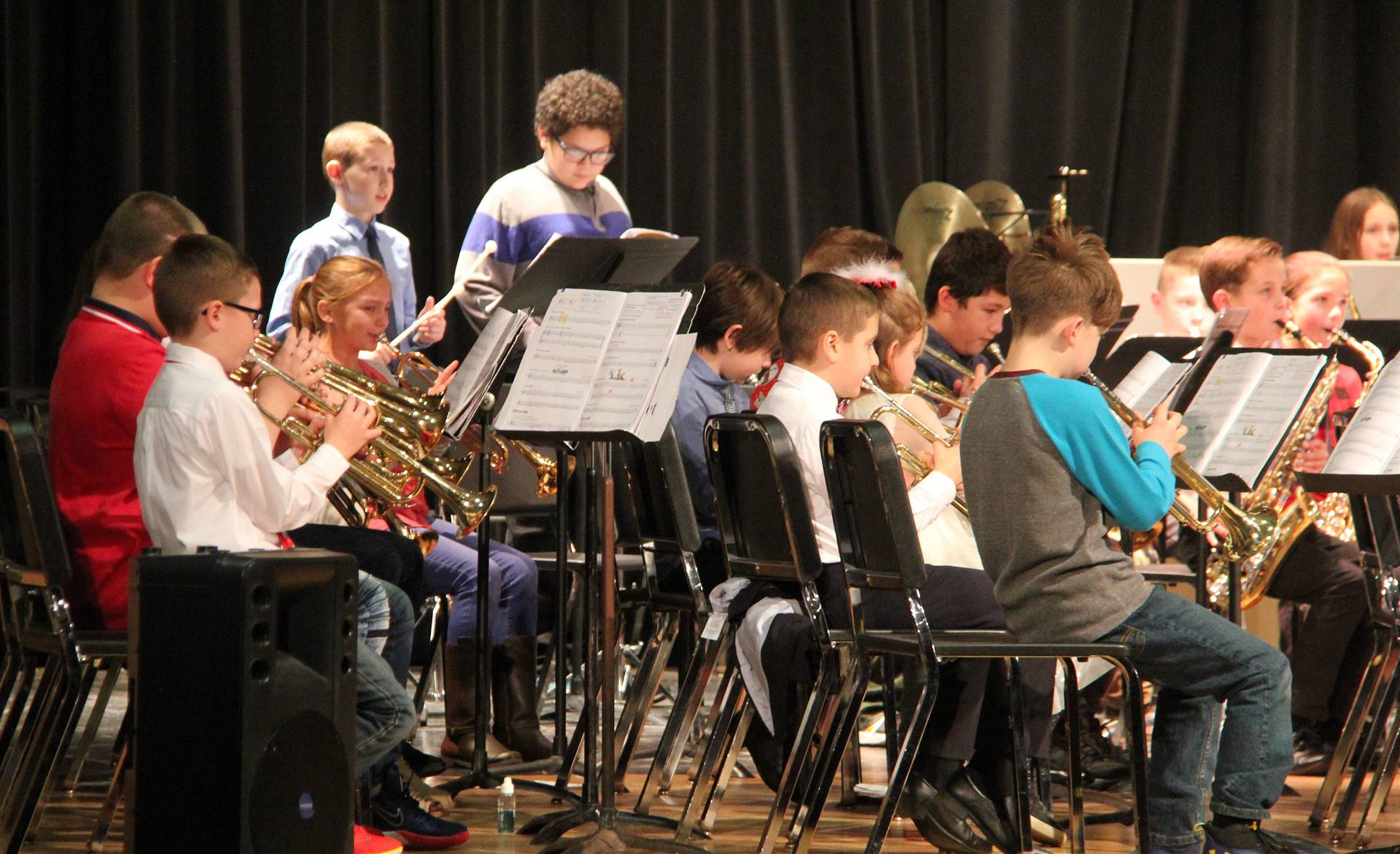 students playing band instruments in concert