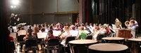 wide shot of band students performing in winter concert