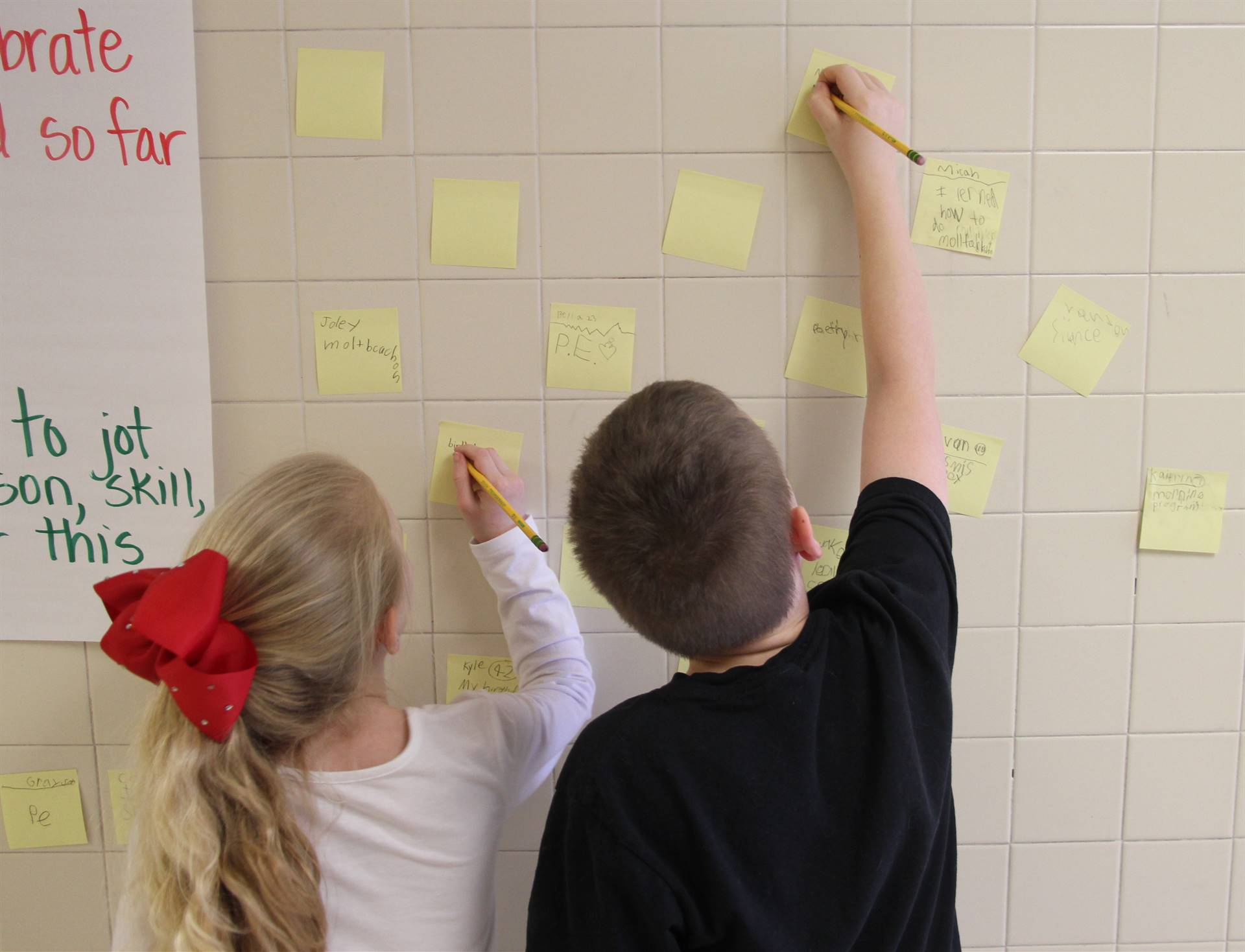 two students writing messages