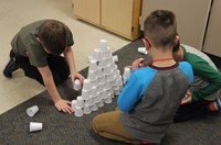 students working on 100 days of school activity in classroom
