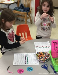 two students working on 100 days of school activity