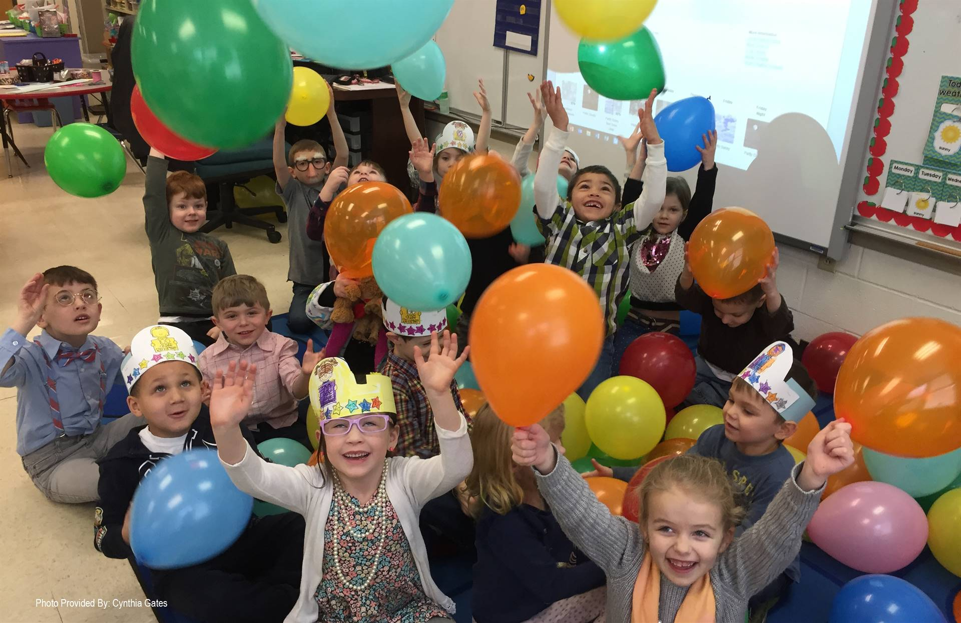students celebrating 100 days of school with balloons