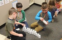 students building cup tower for 100 days of school activity
