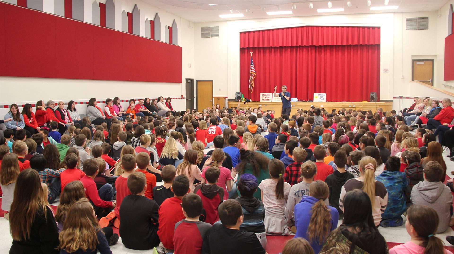 wide shot of presenter speaking with students