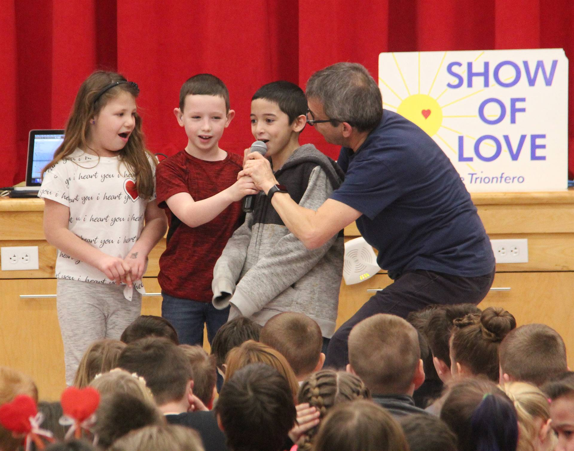 students singing at assembly