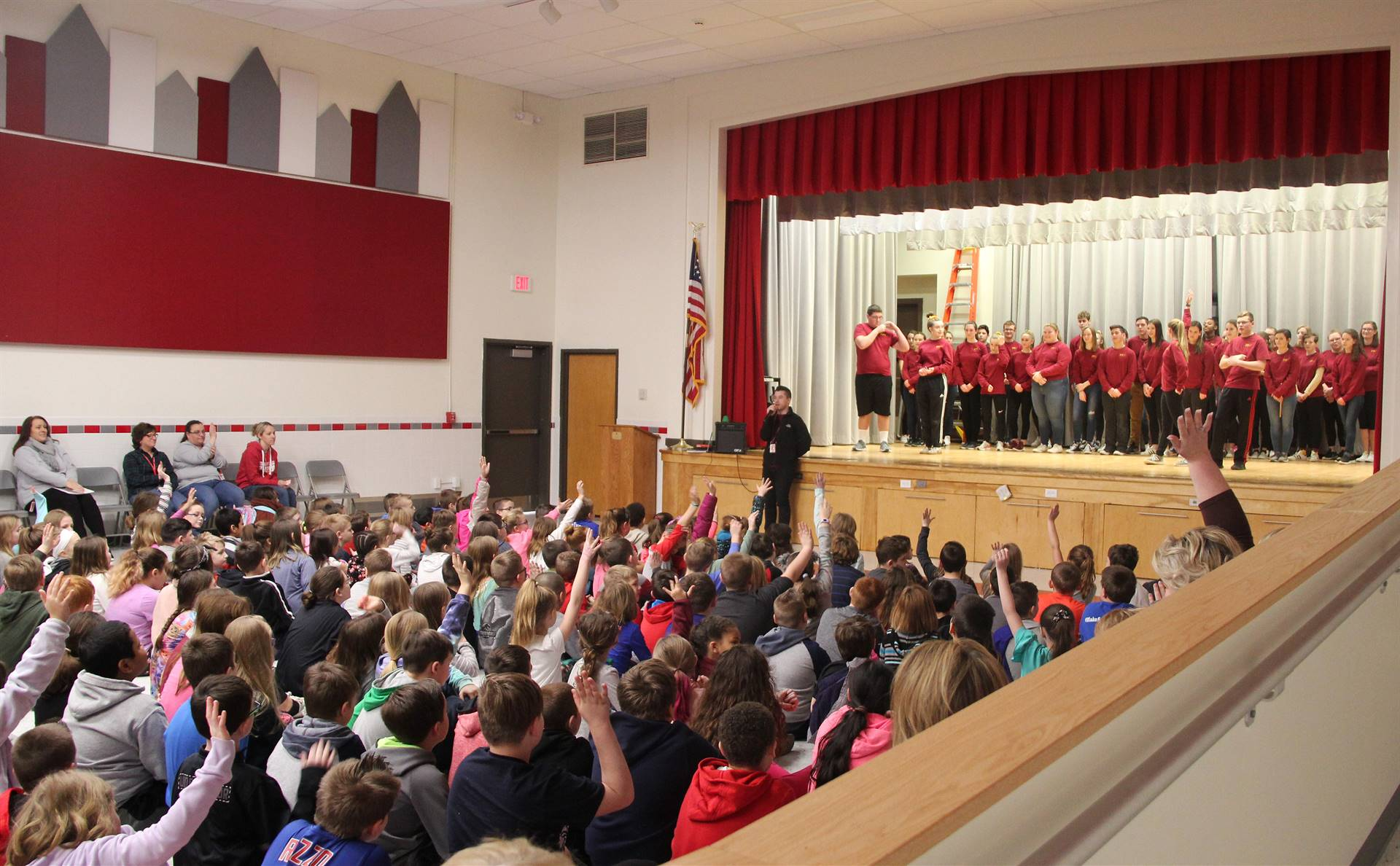 wide shot of mister vanderslice speaking with chenango bridge elementary students