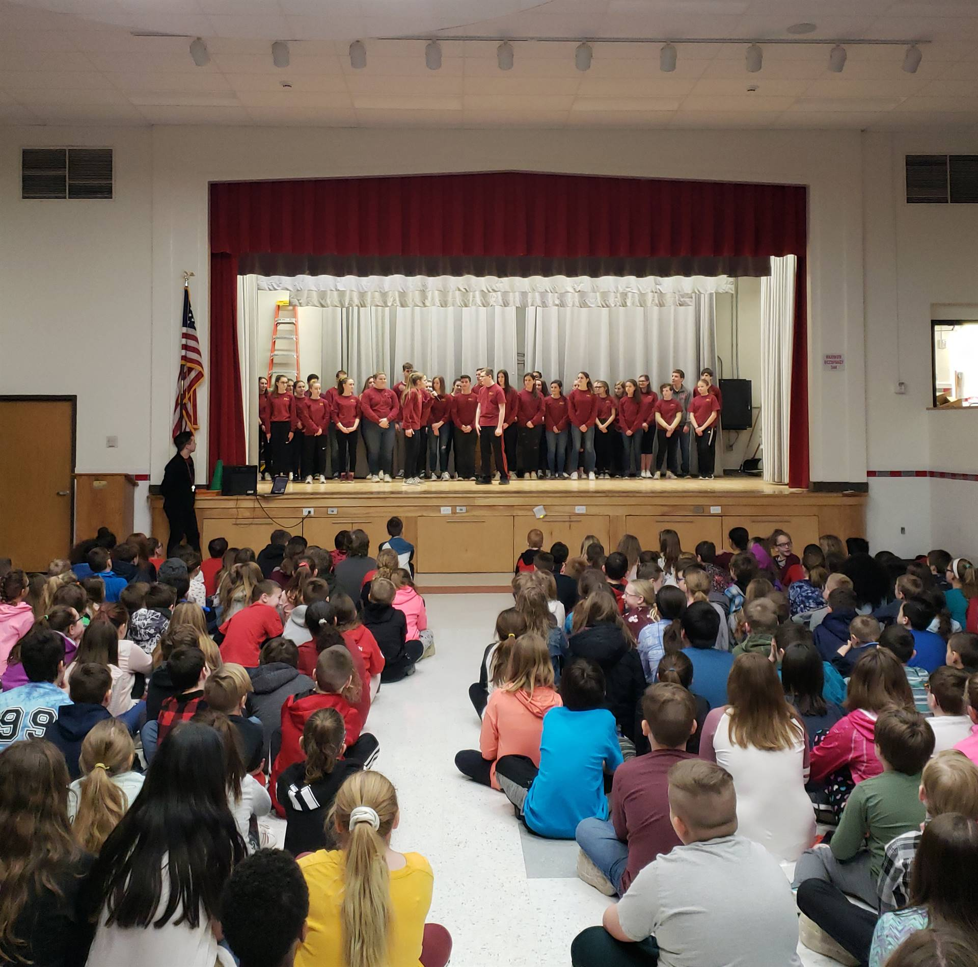 wide shot of theatre guild members performing at chenango bridge elementary