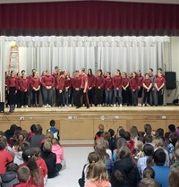medium shot of high school students performing for chenango bridge elementary