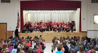 wide shot of high school students performing for chenango bridge elementary