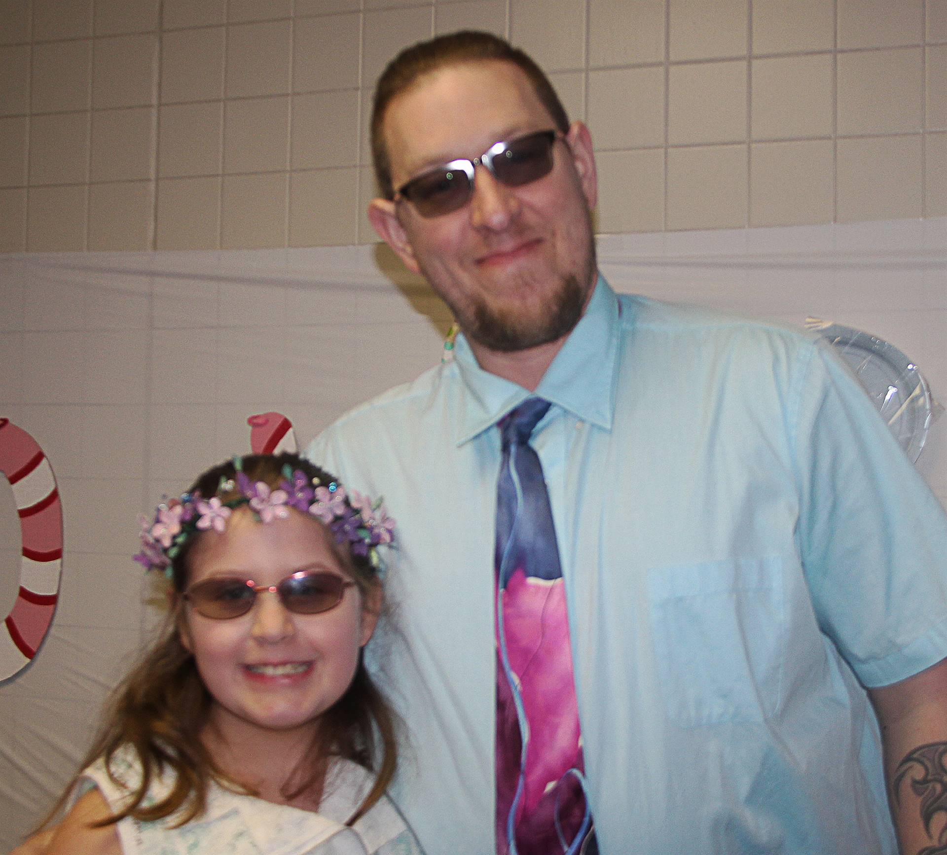 two people wearing sunglasses at winter dance