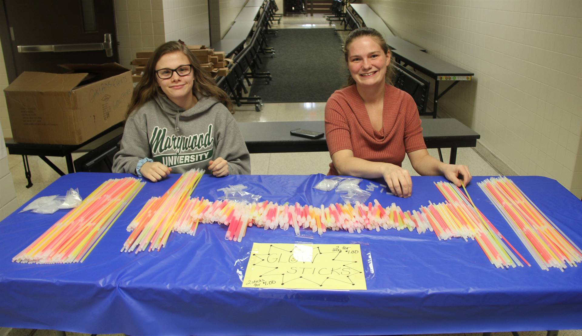volunteers with glow sticks
