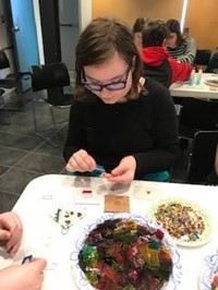 student working on glass project