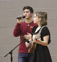 two high school students singing
