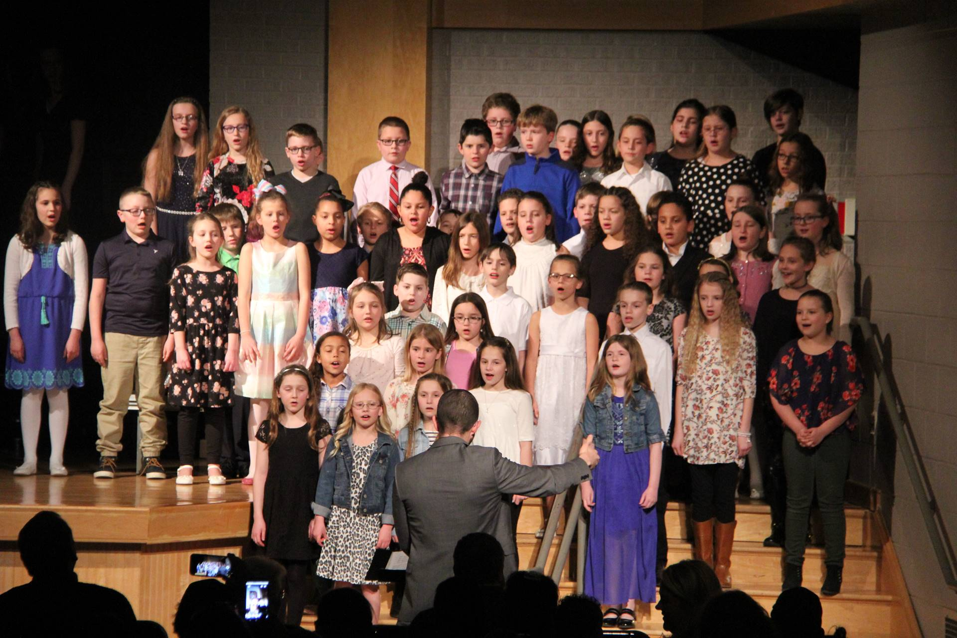 students singing in chenango valley warriors for peace concert 11