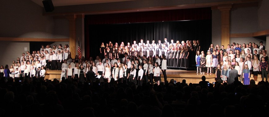 grades 4 through 12 students singing in chenango valley warriors for peace concert