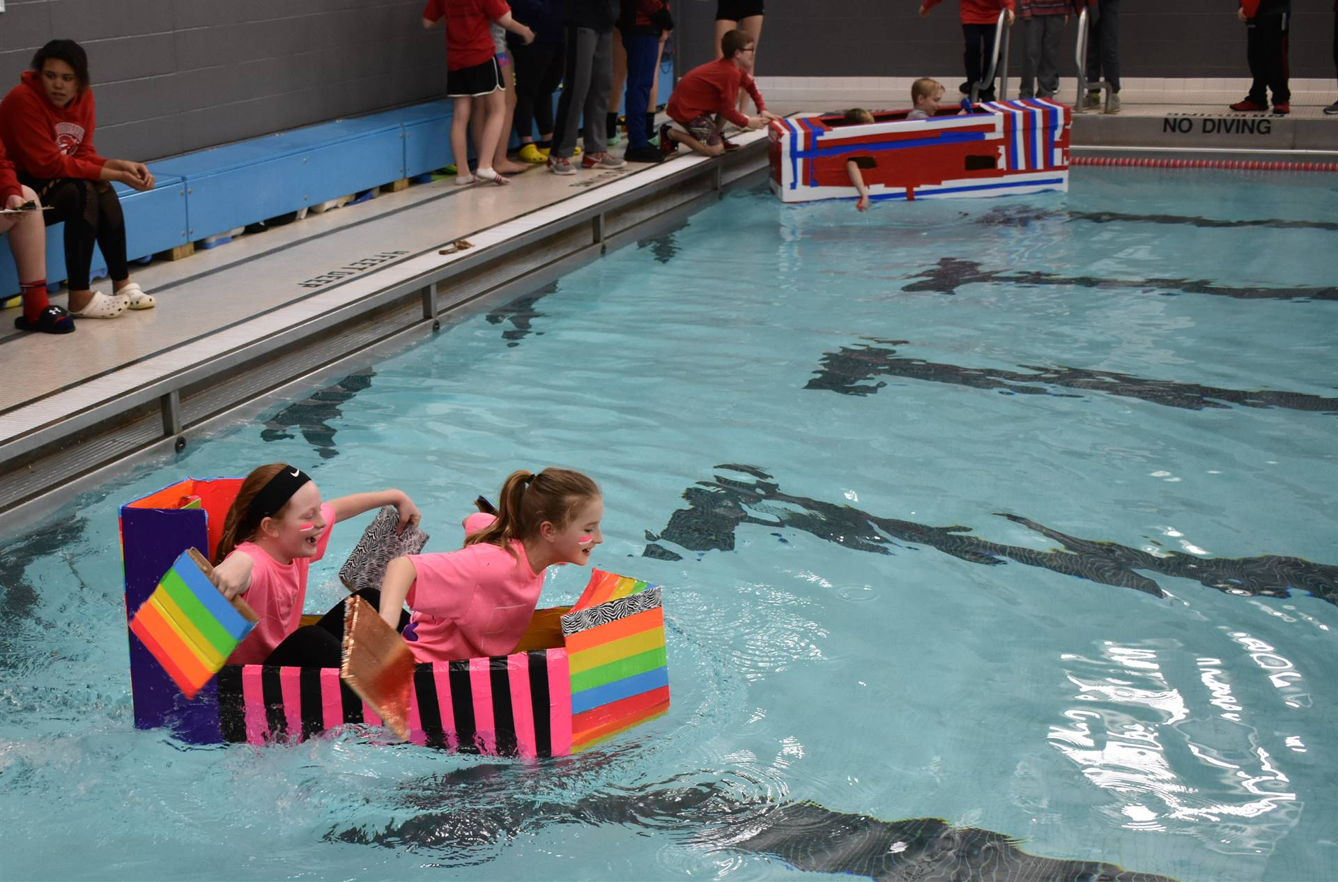 students competing in cardboard boat races