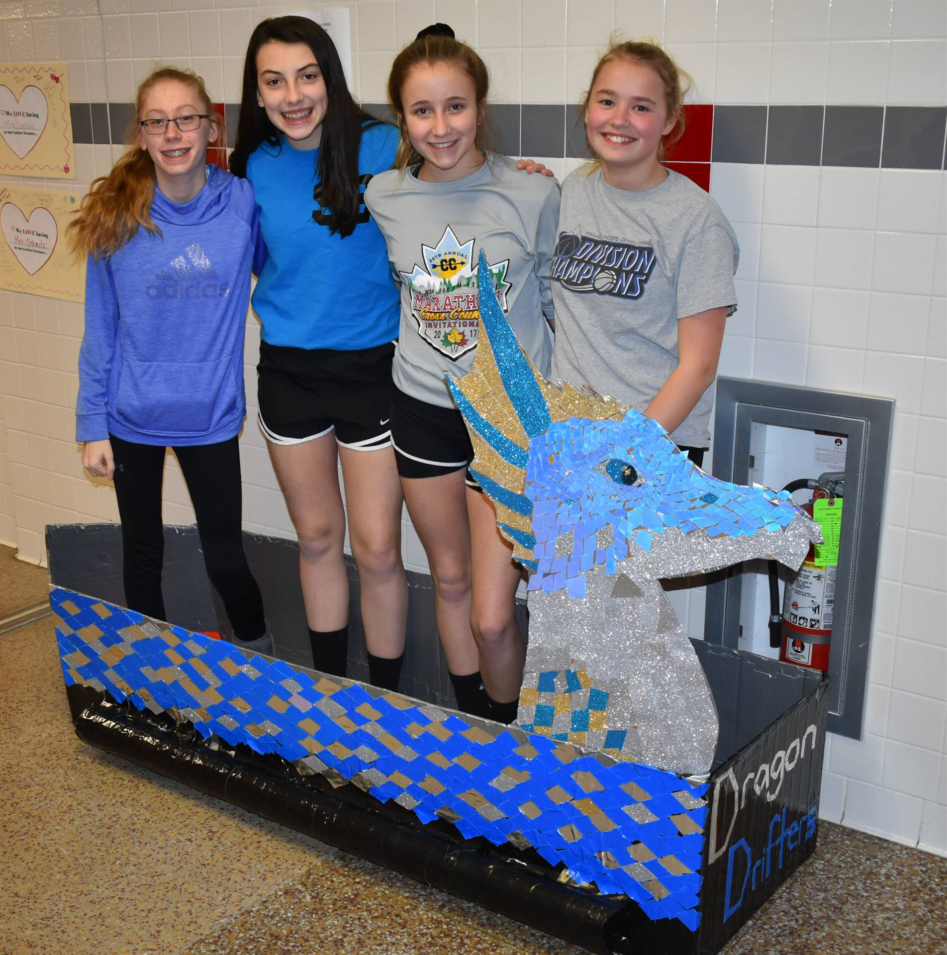 students standing in their cardboard boat