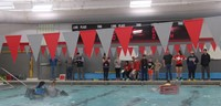 wide shot of students competing in boat races