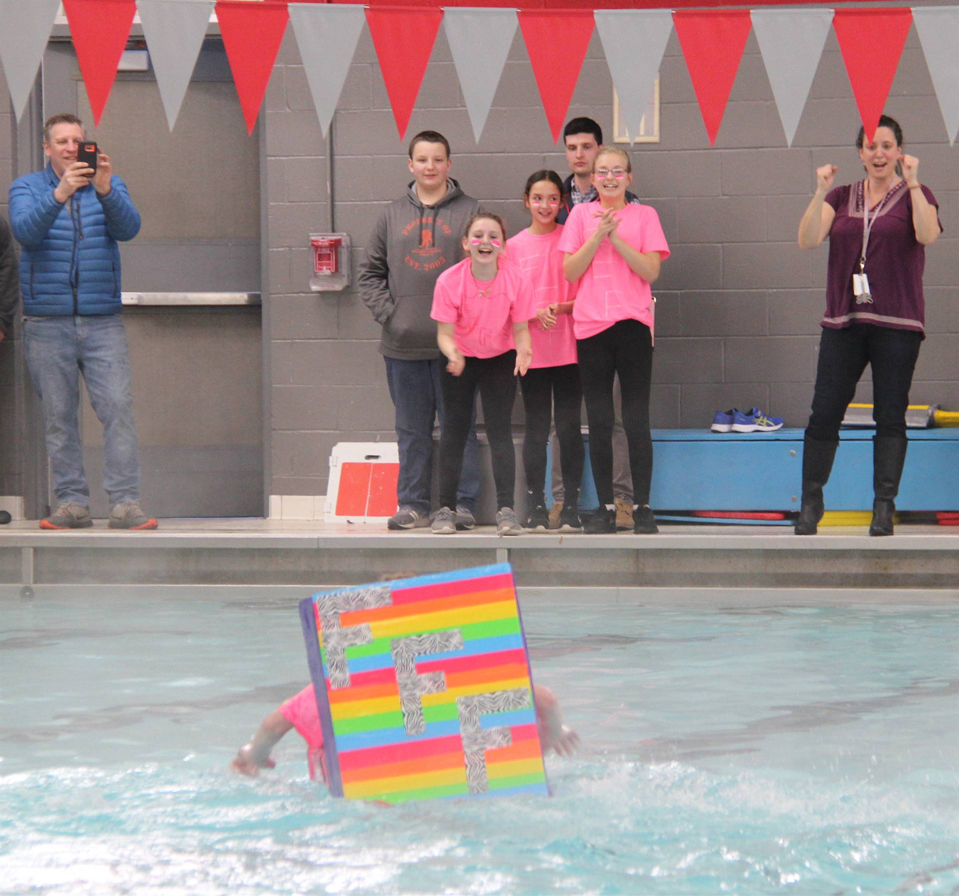 students competing in cardboard boat race