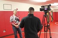 principal being interviewed by reporter