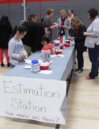students taking part in estimation station activity