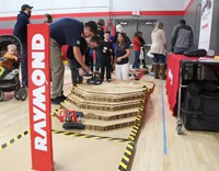 raymond representatives showing students robotic demonstration