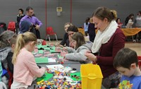 students playing with legos for activity