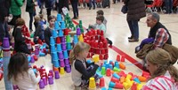 multiple students stacking cups
