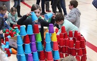 student stacking cup tower