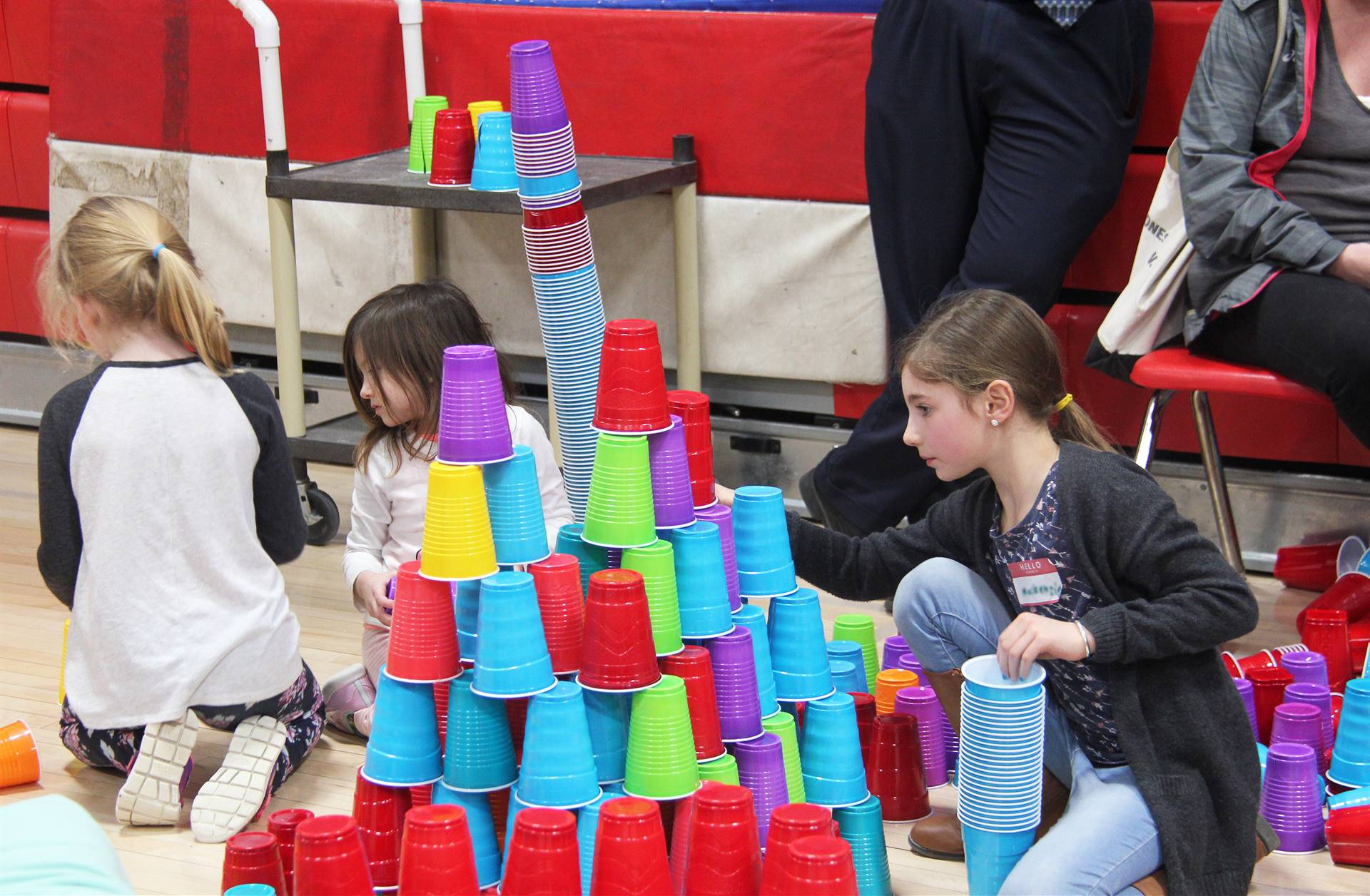 students stacking cup towers