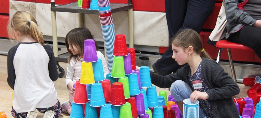 students taking part in steam night cup stacking activity