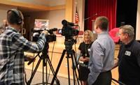 presenter speaking with media