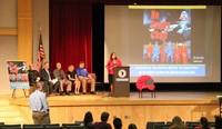 principal ostrander speaking at podium