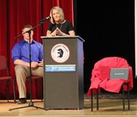 presenter speaking at podium