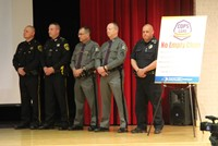 law enforcement officials standing next to no empty chair poster