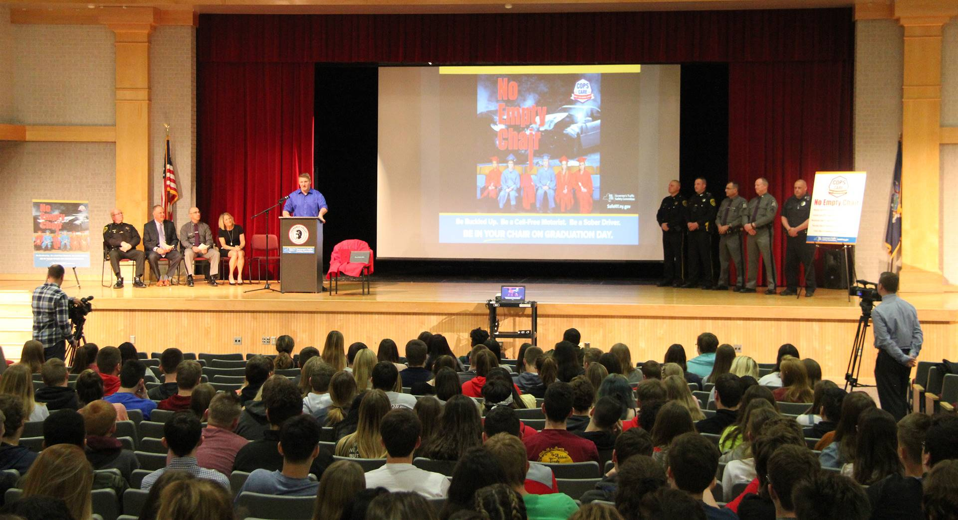 wide shot of lucas scott speaking at no empty chair campaign kick off presentation