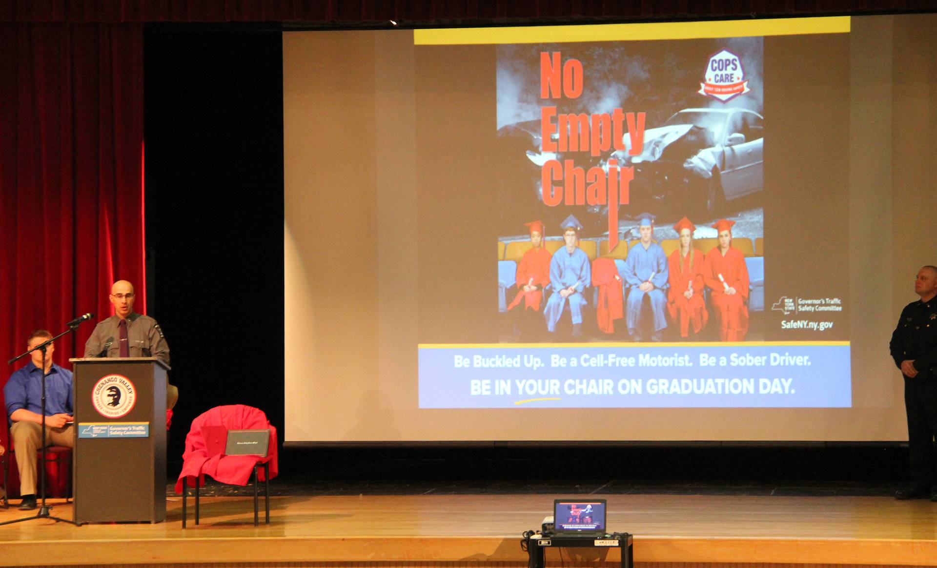 medium shot of law enforcement official speaking at no empty chair campaign kick off presentation