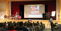 wide shot of presenter speaking at no empty chair campaign kick off presentation