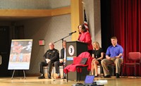 medium shot of principal ostrander speaking at law enforcement official speaking at no empty chair c