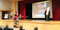wide shot of principal ostrander speaking at law enforcement official speaking at no empty chair cam