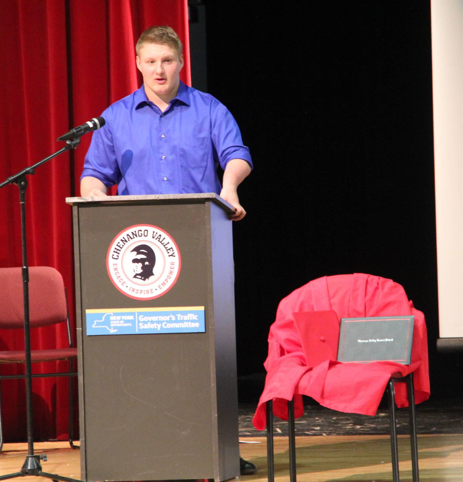 medium shot of of lucas scott speaking at no empty chair campaign kick off presentation