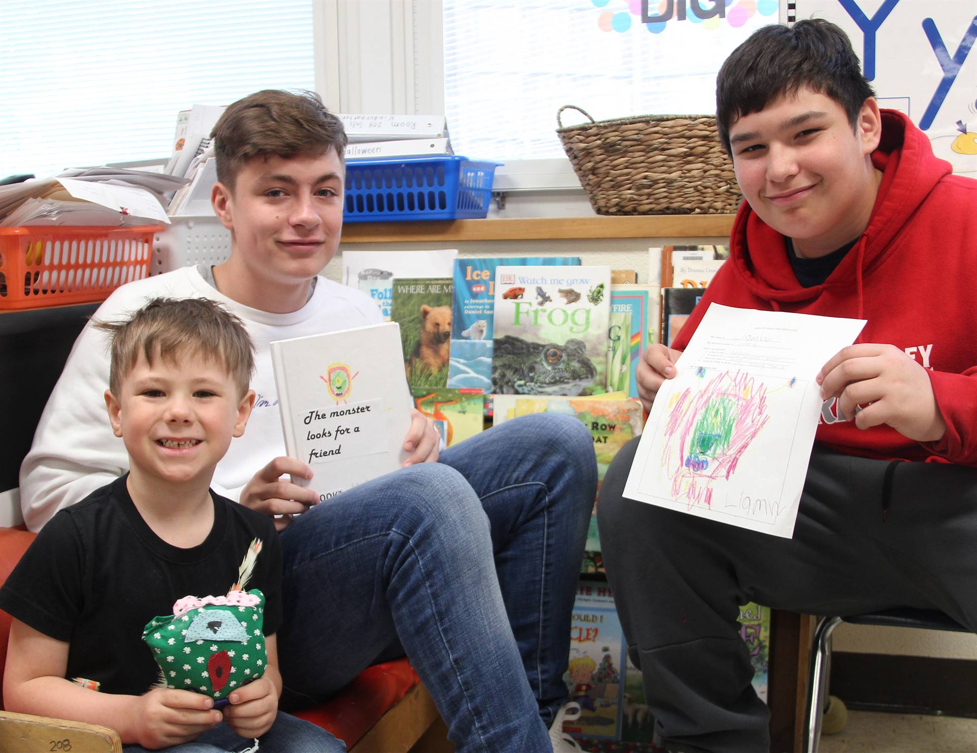 students with books, drawings and sewn monsters 9